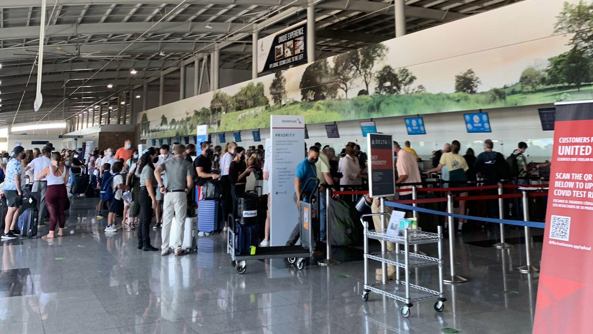 International travel's current hurdles: Travelers waiting to produce proof of a negative Covid-19 test in Costa Rica.